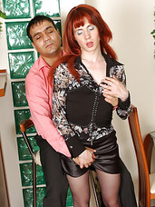 Lusty sissy guy in a red wig and female clothes takes the most from gay sex