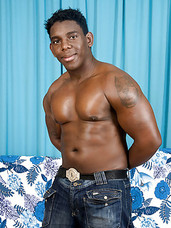 Beefy black stud strips down and teases