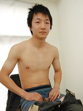 Japanese stud Ryoji Tomita discreetly jerks off while he looks at a porn magazine.