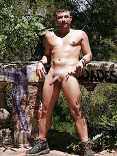 Hiking through the forest, Manu Perronash hears familiar sounds. Curious, he approaches an abandoned, crumbling house just outside of Barcelona. There, he spots two men fucking and is instantly hard. He pulls his dick out, starts stroking, and keeps watch