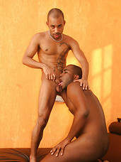 Young athletic ebony studs have gay sex in bedroom