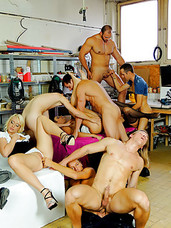 Bisexual fellows fucking each other at a big car workshop