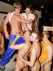 Gorgeous gay guys enjoy drilling at a huge fucking party