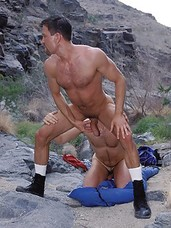 16 photos of two hunks Matt and Eric fucking bareback in a canyon.