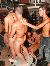 Wild and crazy gay men in an oiled up groupsex orgy party