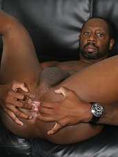 Ebony dude Hole Hunter teasing his asshole while a white dude is watching.