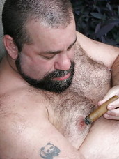 "Cajun Bear and Wayne Daniels are two super hot, belly bulging, stogie smokin"" bears who decide to take advantage of the summer sun poolside.  Both these guys share a love for big furry cocks, eating bear ass and smoking cigars.  If you like seeing f"