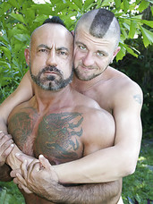 Bo Bangor and Christian Matthews have taken refuge from the heat of the hot South Florida sun. Except that our wandering cameraman, as well as being outdoors, have gotten both men horny. Dropping everything, Bo and Christian take turns sucking each other