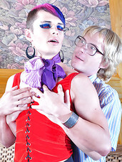 Funky sissy with crazy hair seduces a geeky boy into male-on-male action